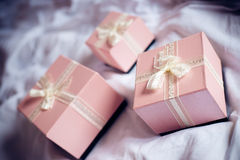 3 gorgeous beautiful luxury boxes pink presents with white ribbon on white bed background picture Royalty Free Stock Photos