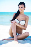 Gorgeous and beautiful young girl relaxing on the beach Royalty Free Stock Photo