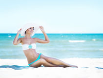 Gorgeous and beautiful young girl relaxing on a summer beach Royalty Free Stock Photos