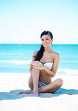 Gorgeous and beautiful young girl relaxing on a summer beach Stock Images