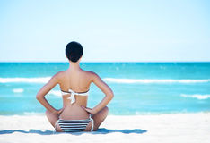 Gorgeous and beautiful young girl relaxing on a summer beach Royalty Free Stock Image