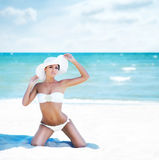 Gorgeous and beautiful young girl relaxing on a summer beach Royalty Free Stock Images