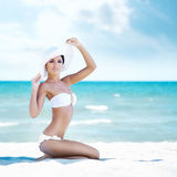 Gorgeous and beautiful young girl relaxing on a summer beach Stock Photo