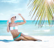 Gorgeous and beautiful young girl relaxing on a summer beach Royalty Free Stock Photo