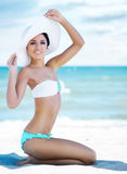 Gorgeous and beautiful young girl relaxing on a summer beach Royalty Free Stock Photography