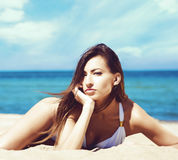 Gorgeous and beautiful young girl relaxing on a summer beach Stock Image
