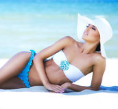 Gorgeous and beautiful young girl relaxing on a summer beach Stock Photos