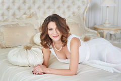 Gorgeous beautiful young woman lying on a sofa Stock Photography