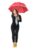 Gorgeous beauty with scarf and umbrella in black jumpsuit blowing air kiss Stock Images