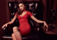 Gorgeous Beauty Young Brunette Woman In A Leather Chair Stock Photos