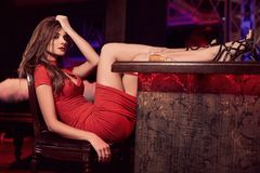Gorgeous beauty young brunette woman in red dress with glass of Stock Images