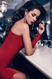 Gorgeous beauty young brunette woman in red dress royalty free stock photos
