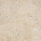 Gorgeous beige marble with natural pattern. Stock Photos