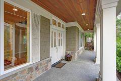 Gorgeous big Craftsman home with lovely covered porch. stock photos
