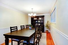Gorgeous black dinner table chair set in dining room. Stock Image