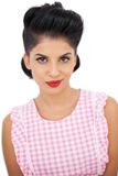 Gorgeous black hair model looking at camera. On white background Royalty Free Stock Photography