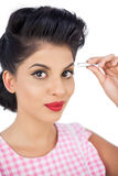 Gorgeous black hair model using a tweezer Stock Image