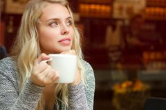 Gorgeous blond drinking coffee. Royalty Free Stock Photo