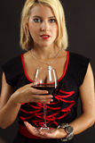 Gorgeous blond drinking red wine Stock Photo