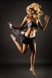Gorgeous blond female jumping Royalty Free Stock Image