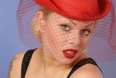 Gorgeous blond girl in fifties pinup hat Royalty Free Stock Photography