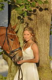 Gorgeous blond girl with a horse Stock Photo