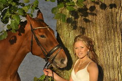 Gorgeous blond girl with a horse Stock Images