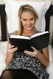 Gorgeous Blond Girl Reading Diary Royalty Free Stock Image