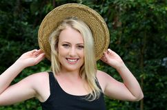 Gorgeous Blond Girl in Straw Hat Royalty Free Stock Photography