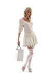 Gorgeous blond with shopping b. Ag over white Royalty Free Stock Image