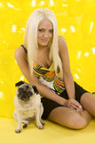 Gorgeous blond skirt balloons pug Stock Photo