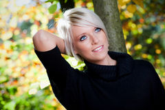 Gorgeous blond woman in autumn Royalty Free Stock Photo