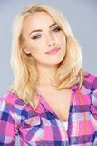 Gorgeous blond woman with a dreamy expression Stock Images
