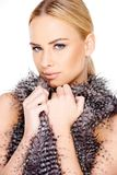 Gorgeous Blond Woman Embracing Feather Cloth Stock Images