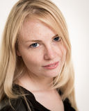 Gorgeous Blond Woman With Freckles Against A White Background Royalty Free Stock Photography