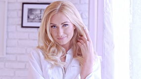 Gorgeous Blond Woman Looking at the Camera stock footage