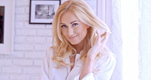 Gorgeous Blond Woman Looking at the Camera Royalty Free Stock Photos