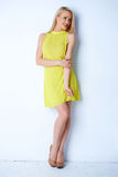 Gorgeous blond woman posing in yellow dress Stock Images