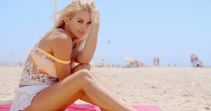 Gorgeous Blond Woman Sitting at the Beach Sand stock video