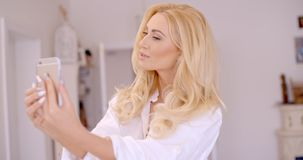 Gorgeous Blond Woman Taking Selfie Photo Royalty Free Stock Photos