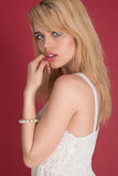 Gorgeous Blond Woman in White Isolated on Red Royalty Free Stock Photo