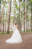 Gorgeous  Blonde bride with bouquet outdoor, posing Royalty Free Stock Photos