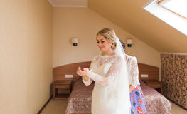 Gorgeous blonde bride in wedding dress  waiting for groom. Stock Photography