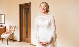 Gorgeous blonde bride in wedding dress  waiting for groom. Royalty Free Stock Photography