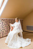 Gorgeous blonde bride in wedding dress  waiting for groom. Royalty Free Stock Image