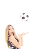 Gorgeous blonde catching soccer ball. Isolated on white Royalty Free Stock Photos