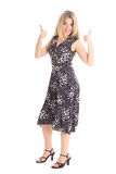 Gorgeous blonde in dress thumbs up. Isolated on white Stock Images