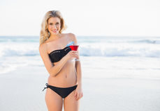 Gorgeous blonde in elegant bikini holding cocktail Royalty Free Stock Image