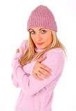 Gorgeous blonde feeling cold. Blonde girl in freezing pose having pink cap and pullover Stock Photography