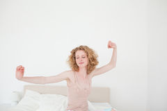 Gorgeous blonde female stretching in her bedroom Royalty Free Stock Photo